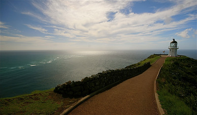 'Where the Tasman Sea and the Pacific Ocean meet.' Cape Reinga, The Far North.  Noordereiland, Nieuw-Zeeland.