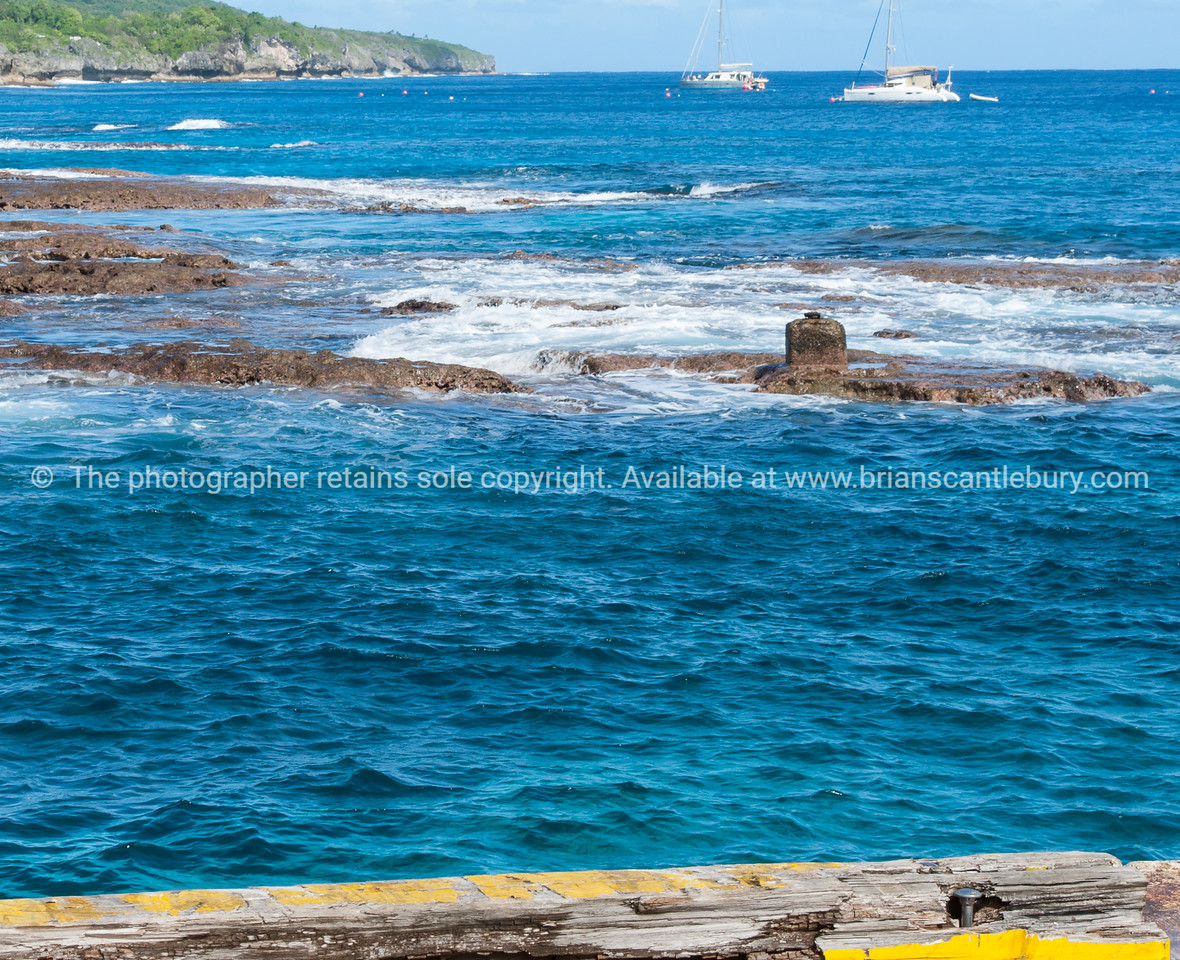 View to moored yachts beyond reef , Niue.