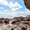Exploring rock pools on coral shelf on tropical Niue
