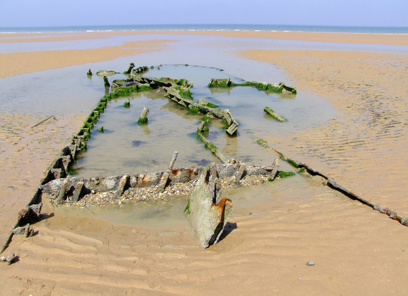 We aren't sure but we think this is an old Allied landing craft.  The tide was out so we could see some of the remaining wreckage from the 1944 invasion.