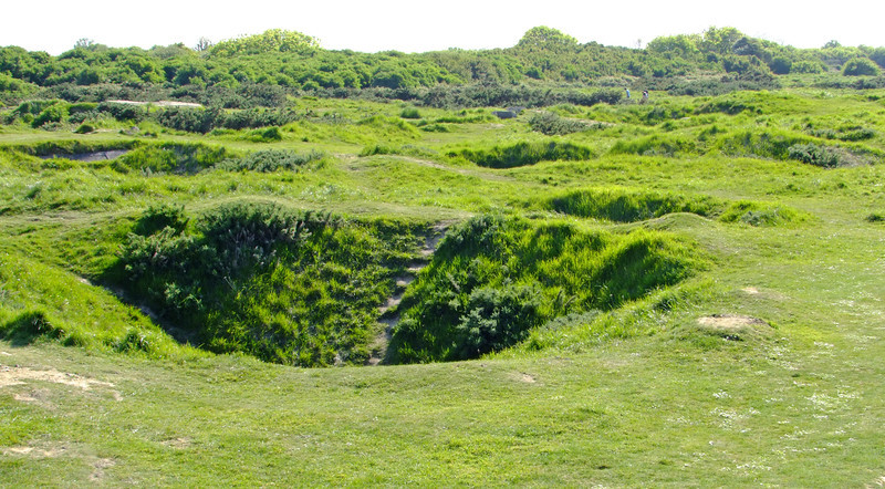 The bomb craters from Allied airplanes and ship artillery are still very visible.  The Allies were trying to knock out the big German guns prior to the invasion.