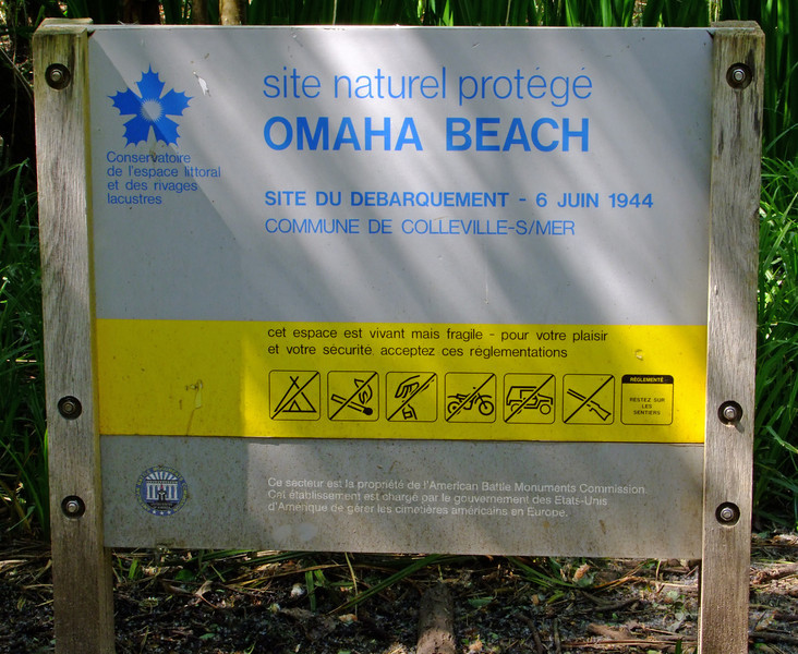There is a nature preserve at Omaha Beach now.  It includes a swamp that the Allied troops had to cross to get to the top of the hill.