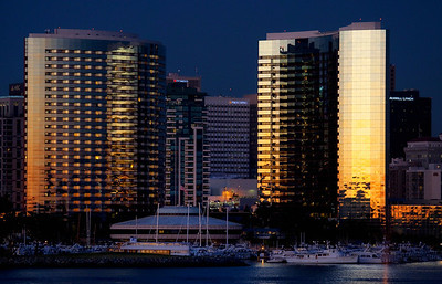 Sunsetting on San Diego harbor buildings