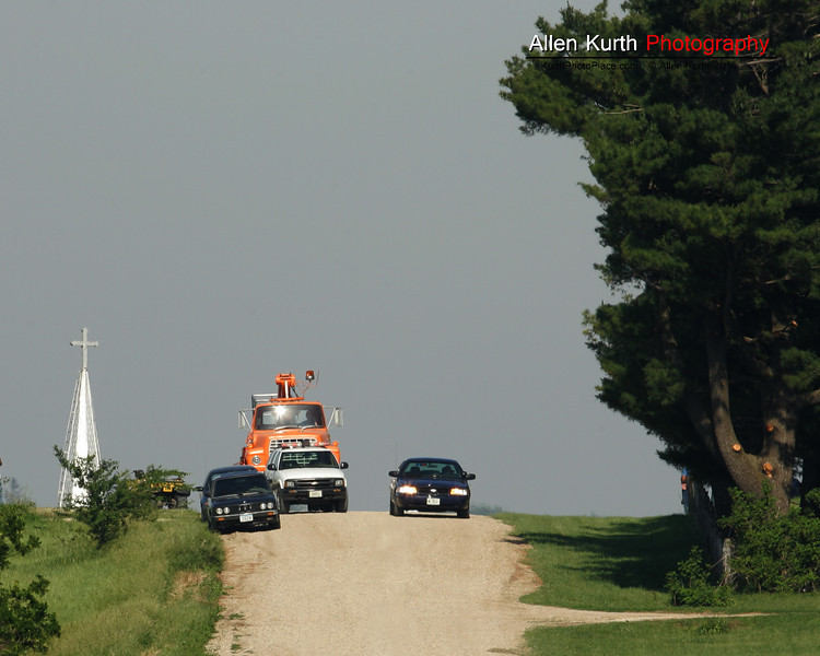 This section of Iowa is anything but flat.  In this photo the church is ascending one of the areas steep loess hills.