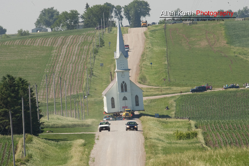 The move was successful.  The church now resides in a historic park in Manning Iowa.