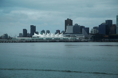 Vancouver, British Columbia, Canada The beautiful white sails of Canada Place stand out against the cloudy day view of the Vancouver, British Columbia skyline.