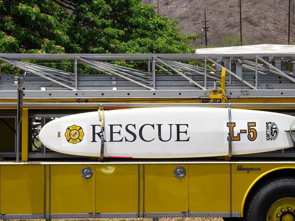 Surfboard on a firetruck in Waikiki.