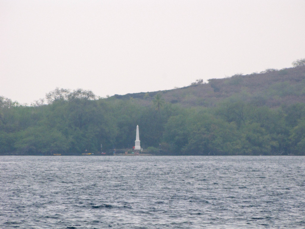 The Captain Cook monument, viewed across the bay from Kealakekua Bay Park.