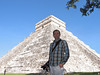 Wayne standing on the southeast corner (back) of El Castillo-Chichén Itzá. In contrast the temples of the Puuc region, the style here shows influence of Toltec style from the altiplano of central Mexico.
