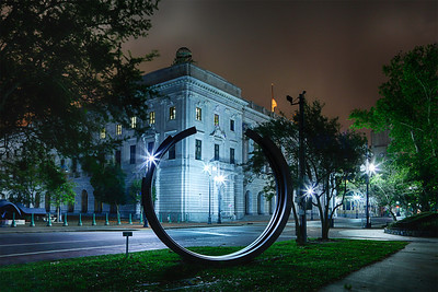 New Orleans, Louisiana Looking through a circular sculpture in Lafayette Square at the United States Fifth Circuit Court of Appeals building.