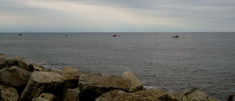 Suction dredges off East Beach