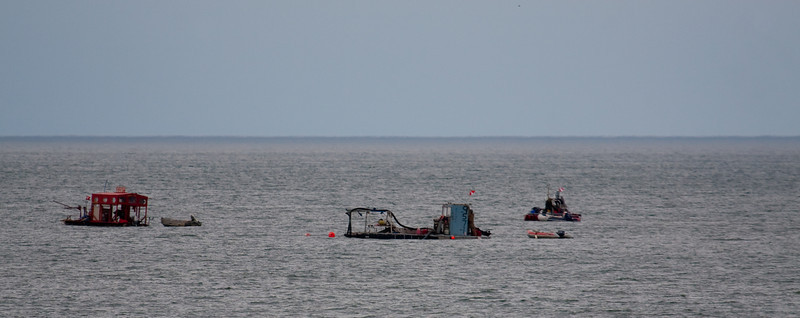 Suction dredges in the water off East Beach