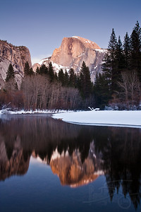 half dome and the merced river at winter. yosemite national park, ca