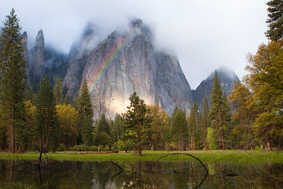 Morning rainbow in Yosemite valley. Yosemite National Park, CA