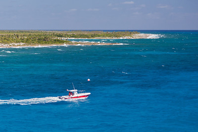 Costa Maya, Mexico A small boat motors passed the Costa Maya peninsula.