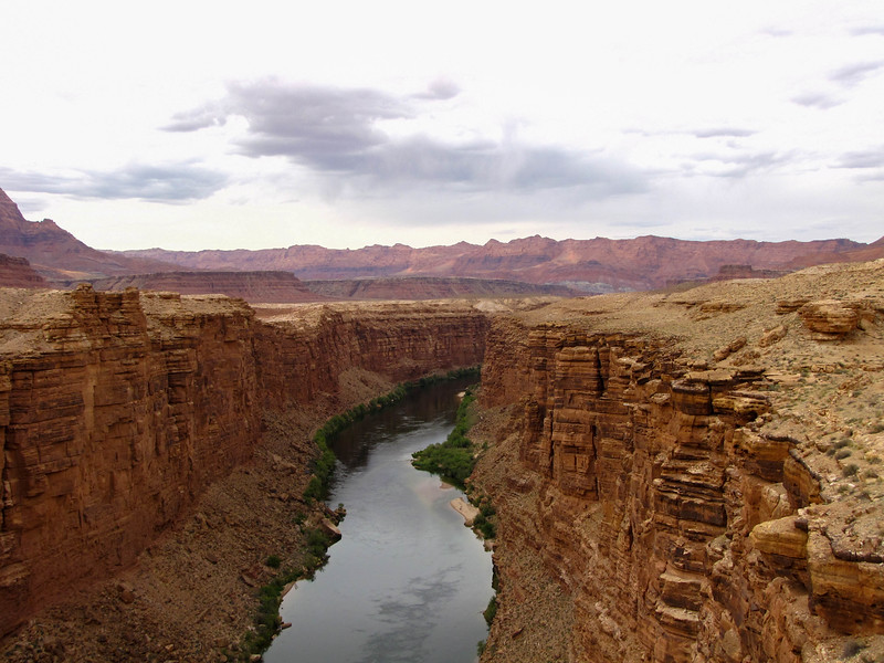 The Colorado River passes under the highway and Navajo Bridge at Marble Canyon, AZ. This is essentially the start of the Grand Canyon.