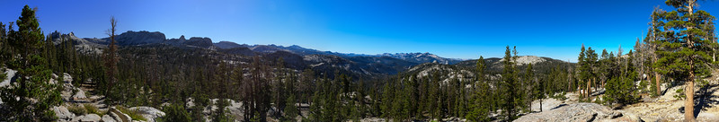 Panorama from the JMT taken near the Columbia Finger facing southeast. Prominent features (left to right) include Echo Peaks, Matthes Ridge, Amelia Earhart Peak, Mt Florence, Mt Foerster, Triple Divide, Quartizte, Bruce, Buena Vista, and Sunrise.