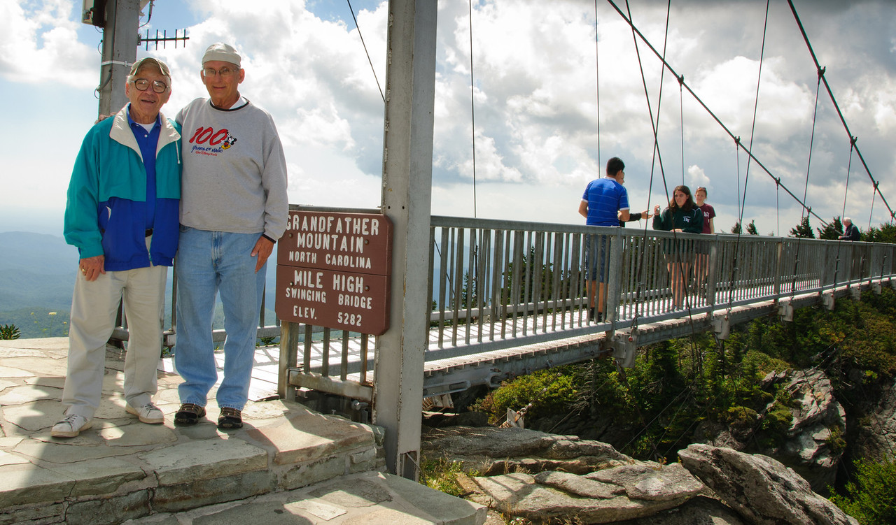 Danny Jacobson and Arnold Dubin standing at the mile high bridge at Grandfather Mountain