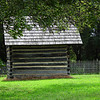 Smokehouse - Bennett Place Historic Site - Durham, NC<br /> This small log building is a representation of the original smokehouse, which stood on this location.  The smokehouse was used by the Bennett Family to cure meat and store gathered vegetables and food supplies.  This building was reconstructed in 1960 using materials from the Proctor farm.