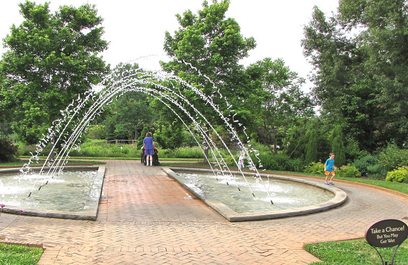 """The Allee Garden - Daniel Stowe Botanical Garden - Belmont, NC  5-12-12<br /> Notice the sign that says, """"Take a Chance!""""  It was fun watching people go through it, especially the little boy that is running on the right.  He just kept circling with delight."""