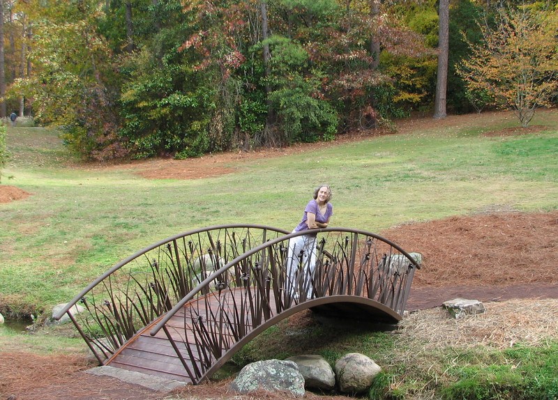 Donna On Sculpted Bridge Over Stream