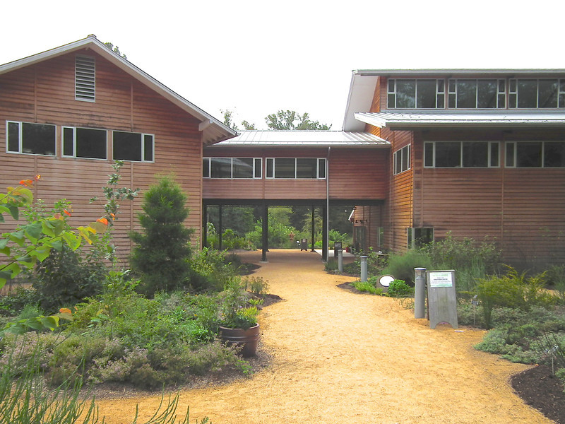 Education Center - North Carolina Botanical Garden at Univ. of NC at Chapel Hill<br /> This LEED Platinum building opened in October 2009, with the highest level of certification for a green building.  It has solar photo-voltaic panels, generating about 7.5% of the building's energy needs, and is heated and air-conditioned with a geothermal system.  All windows are operable and it provides up to 100% of the building's occupied space which results in savings of 60% on electric lighting.
