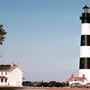 Bodie Island Lighthouse - Outer Banks, NC  10-27-98<br /> The National Park Service operates a visitors center in the old keepers house of Bodie Island Light. Bodie Island is still a working lighthouse with its original first order Fresnel lens, one of the few Fresnel lenses still operating in its original tower.