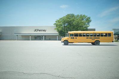 A School Bus Parked outside Empty JC Penny
