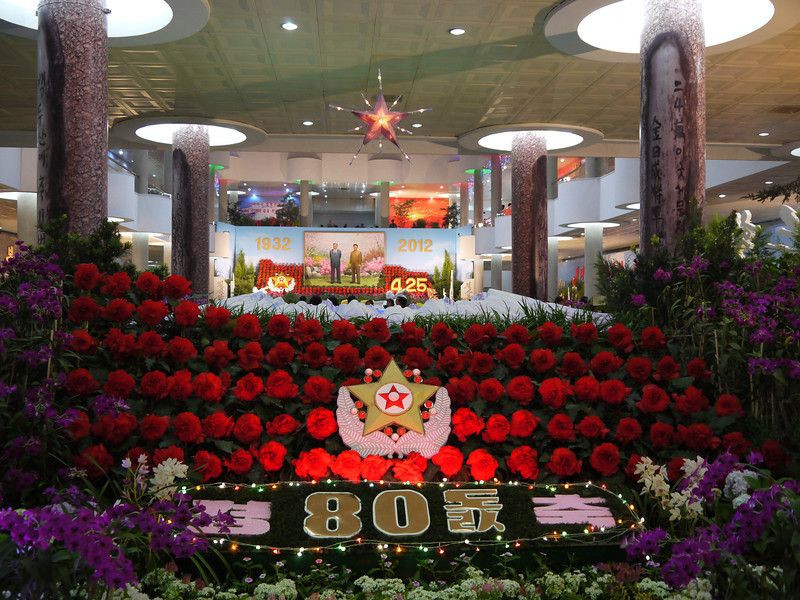 """Pyongyang Flower Show celebrating the 80th anniversary of the North Korean army. The red flowers are called """"Kimjongilia"""" and the purple ones are """"Kimilsungia"""".<br /> <br /> <br /> <a href=""""http://en.wikipedia.org/wiki/Kimjongilia"""">http://en.wikipedia.org/wiki/Kimjongilia</a><br /> <br /> <a href=""""http://en.wikipedia.org/wiki/Kimilsungia"""">http://en.wikipedia.org/wiki/Kimilsungia</a>"""