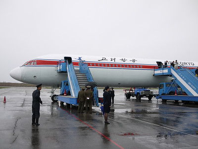 Deplaning the Ilyushin 62 in Pyongyang with military welcome
