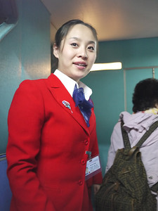 Stewardess welcomes us on Air Koryo