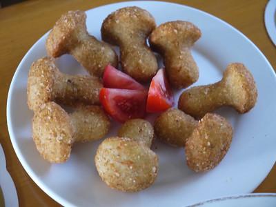 Deep fried mushroom shaped potatoes