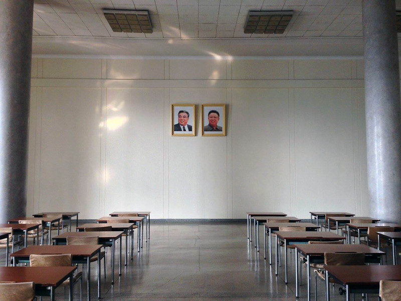 A classroom with portraits of the President Kim-Il Sung and General Jong-II