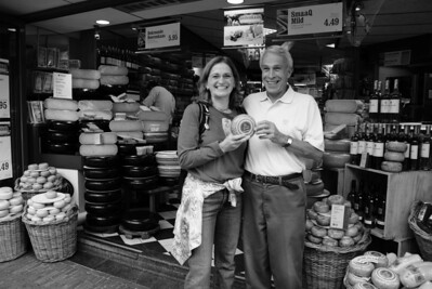 We met the Attaché's family in Haarlem, Holland, about 20 km from Amsterdam. We spent the night there before boarding the ship. We like the town. Here is the Attache and her dad at a cheese shop.