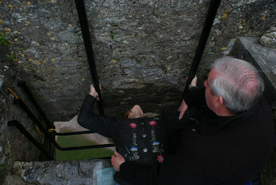 Kissing the Blarney Stone! That's the Attaché doing the backwards hang at Blarney Castle near Cork. The legend of the stone isn't what most people think….  Kissing the stone doesn't bring you luck, it brings you the gift of gab. Even Grammy did the backwards hang. Go Grammy!  We got a special order of good ole Irish weather for our first port, a week of rain in one day. I had arranged to have a rental car delivered to the port, so I got to drive all over Cork County on the left hand side of the road in blinding rain. We saw the city of Cork, Blarney, and the fishing village of Kinsale (about an hour south of Cork).
