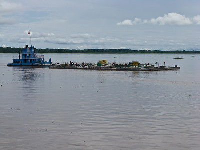 An oil barge. Oil is produced upriver and moved by barge to the terminal.