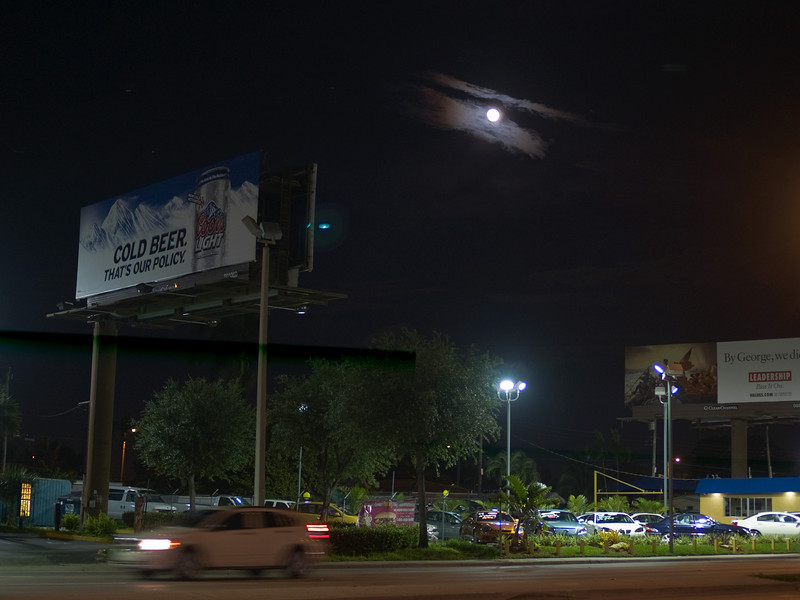 Moonrise over car lot