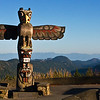 Traveling south on Highway 19 a little north of Victoria, BC this Bear totem overlooks the distant hills. It was carved by Stanley Modeste a Native of the Cowichan Band at Kokgilah, BC in 1966 to commemorate the centennial of the colonies of Vancouver Island joining the mainland as British Columbia. July 1, 2009.