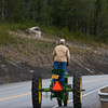 Somewhere on Hwy. 1 east of Anchorage I passed this tractor cruising down the shoulder of the highway. Then a couple of miles later he passed me when I stopped to shoot image captures. Looks like a great way to see the country side. June 21, 2009.