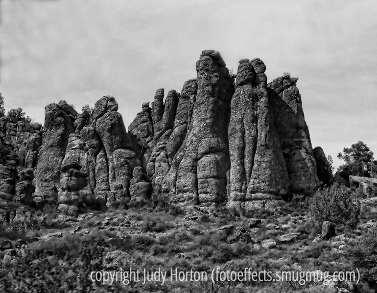 A rock formation along the road near Globe in Arizona; because it was shot through a dirty windshield of a rapidly moving vehicle, it is not of the quality I'd like.