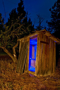 Blue Outhouse Golden, Oregon  Outhouse in the ghost town of Golden, Oregon.  Front lit with a Coleman lantern, interior lit with a blue LED flashlight.