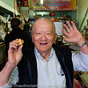 We had to pay $1 to take a couple of pictures in this fortune cookie company. This guy was so happy we were there!