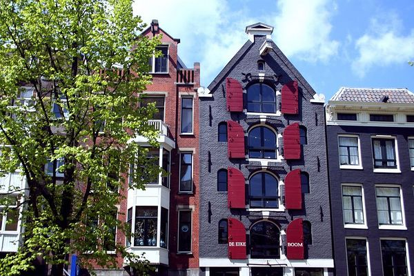 The houses in Amsterdam are very colorful and very well maintained.