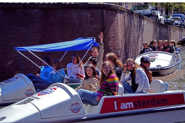 Some school children wave to us from their peddal boat. They were happy to have their picture taken.
