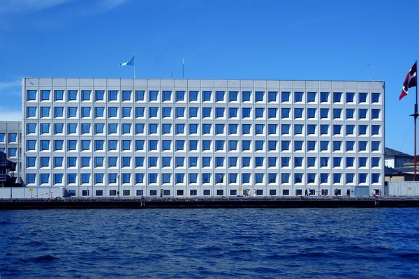 "They call this the building with the ""blue eyes"". It is the headquarters of a large shipping company."