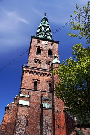 A church bell tower in the middle of town.