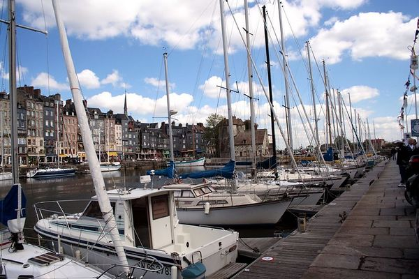 Entering Honfleur we see th Vieux Bassin or Old Harbor. It is now a beautiful Yacht harbor. The weather (early May) was clear and breezy and around 45 degrees Fahrenheit.<br /> This image may be purchased from the WATERSCAPES gallery.