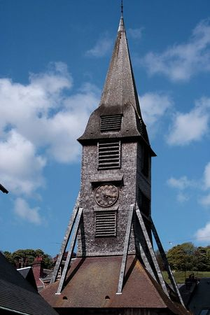 The bell tower of the church. This is actually a separate structure.