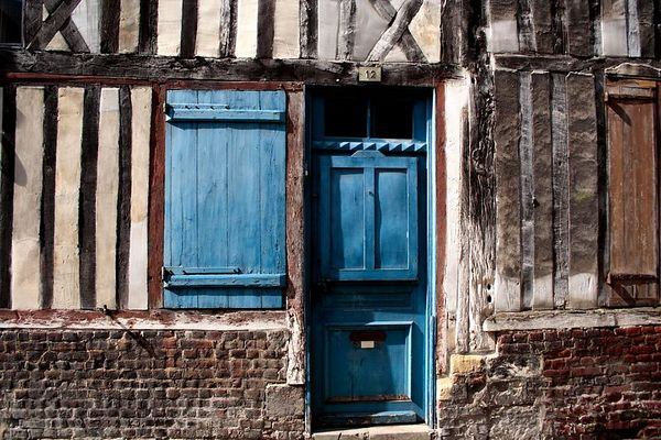This apartment is an example of the beam and mortar construction. I liked the quaint blue door and shutter.<br /> This image may be purchased from the DOORS AND WINDOWS gallery.