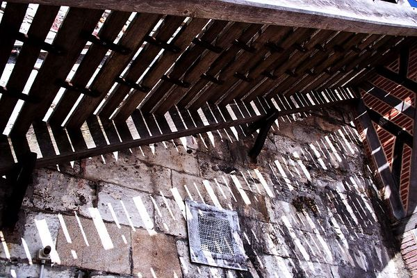 A stairway on the back side of the church shows an example of the construction using beams and brick as well as stone.
